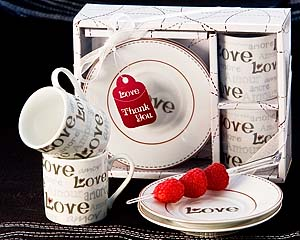 Language of Love Espresso Cup Favor (Set of 2) Love, Amore, Amour, Amor...are key words to anyones heart and this keepsake makes the perfect wedding or party gift. In bomboniere tradition, these beautifully set espresso cups and saucers script Love in multiple languages including English, Italian, French and Spanish and have universal appeal. Gorgeous detail with shades of silver and raspberry red heart accents make this gift more than a practical favor, but an artistic piece worthy of your guests home display cases. Whether a keepsake gift for your one and only or all your wedding guests, this espresso cup set will be the talk of the party. A brilliant gift idea or favor for Valentines day parties, too! Perfectly matching Thank You tag is included along with coordinated display packaging finished with sheer organza ribbon and bow. An original Artisano Designs creation. Material: High quality porcelain. Packaged favor dimensions approx. 7 x 2.25 x 5.25 (18 x 6 x 13.5 cm).